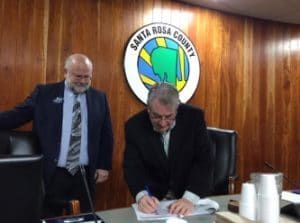 Triumph Chair Don Gaetz and GCSC President John Holdnak sign grant award agreement.